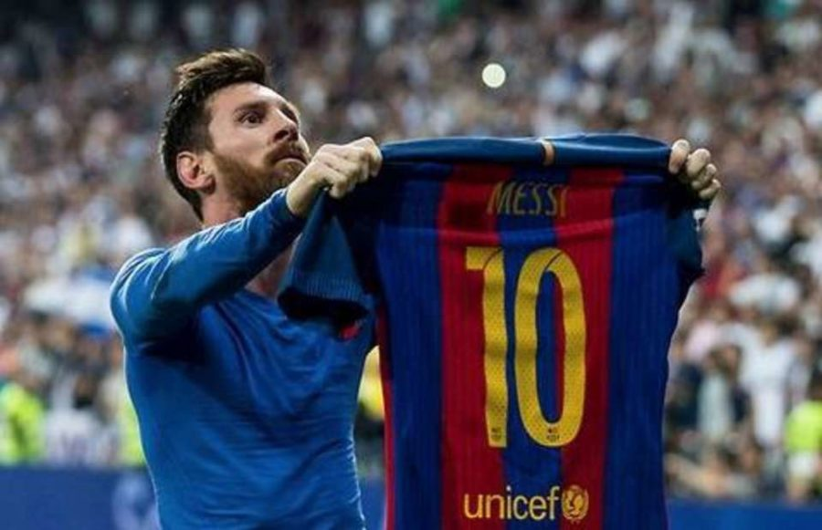 Lionel Messi celebrates a late winner in front of Real Madrid fans.